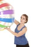 Woman blue striped tank fitness big ball up Stock Photo