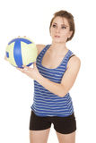 Woman blue striped tank fitness volleyball look side Royalty Free Stock Image