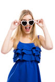 Woman in blue with sunglasses. Beautiful woman in blue dress using sunglasses, isolated over white background Royalty Free Stock Images