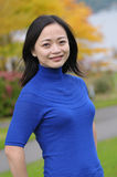 Woman with blue sweater Stock Photography