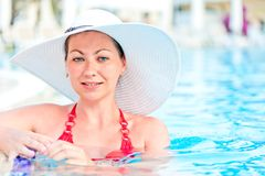 Woman in a blue swimming pool water Stock Image