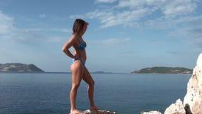 Woman in blue swimwear pose stock footage