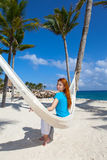 The woman in a blue t-shirt in the hammock Stock Image