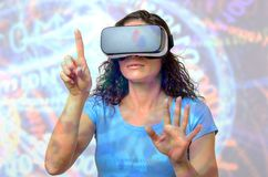 Woman using 3D goggles, pointing with finger royalty free stock photo