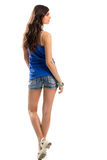 Woman in blue tank top. Back view of short shorts. Casual outfit with sandals. Youth and lightness Royalty Free Stock Image