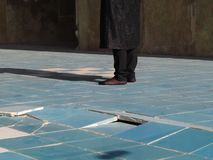 woman on blue tile stock photo