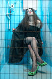 Woman at blue toilet Royalty Free Stock Photography