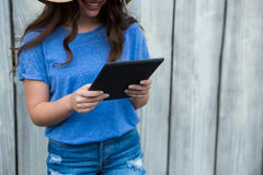 Woman in blue top using digital tablet Stock Image