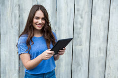 Woman in blue top using digital tablet Royalty Free Stock Photography