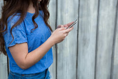 Woman in blue top using mobile phone Stock Photos