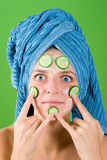 Woman in blue towel and mask from cucumber Royalty Free Stock Photography