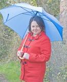 Woman with blue umbrella Stock Photos