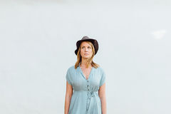 Woman in Blue V Neck Dress With Black Hat Royalty Free Stock Photo
