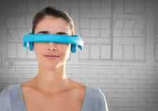 Woman in blue virtual reality headset against grey hand drawn windows Royalty Free Stock Images