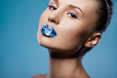 Woman with blue visage Royalty Free Stock Photo