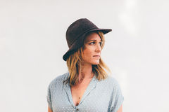 Woman in Blue and White Polka Dots Button Up Shirt Wearing Black Hat Standing Stock Photo