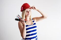 Woman in Blue and White Tank Top Wearing Red Hard Hat Stock Images