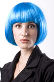 Woman in blue wig. Young beautiful woman in black jacket and blue wig Stock Image