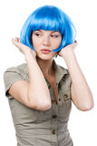 Woman in blue wig Stock Images