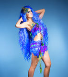Woman in Blue Wig and Dress of Feathers Royalty Free Stock Image