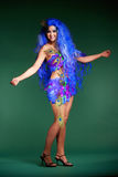 Woman in Blue Wig and Dress of Feathers Royalty Free Stock Images