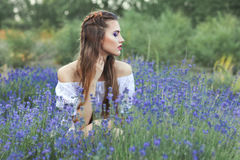 Woman among the blue wildflowers. Royalty Free Stock Images