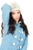 Woman in a blue wool sweater. Portrait of a young black hair woman in a blue wool sweater, isolated on white background Royalty Free Stock Photo