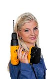 Woman in blue work clothes with drill Stock Image