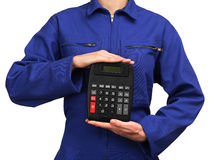 Woman in blue work uniform holding a calculator Stock Photos
