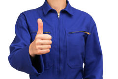 Woman in blue work uniform making the OK sign Royalty Free Stock Image