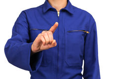 Woman in blue work uniform touching or pointing at something with his finger Stock Photo
