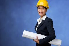 Woman with blueprints Stock Image