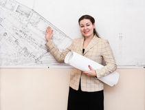 Woman with blueprints on presentation Royalty Free Stock Images