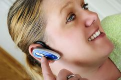 Woman on bluetooth. A young family woman on her bluetooth Royalty Free Stock Photo