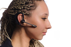 Woman with bluetooth hands-free headset Royalty Free Stock Image