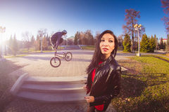Woman and BMX cyclist doing a stunt jump royalty free stock photo