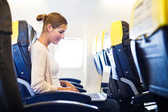 Woman on board of an airplane stock photo