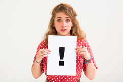 Woman with board exclamation point Royalty Free Stock Images