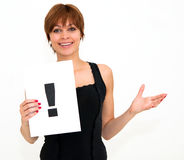 Woman with board exclamation point Stock Photo