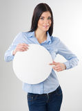 Woman with board. Woman pointing to a blank board Royalty Free Stock Images