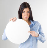 Woman with board. Woman pointing to a blank board Stock Image