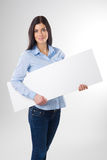 Woman with board Stock Photo