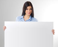 Woman with board. Woman portrait with blank white board Royalty Free Stock Photography