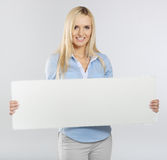Woman with board Stock Photography
