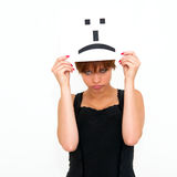Woman with board sad emoticon face sign Stock Images