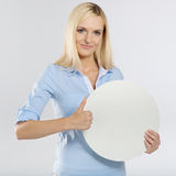 Woman with board and showing thumb up sign. Young woman with blank circle board and showing thumb up sign Royalty Free Stock Image