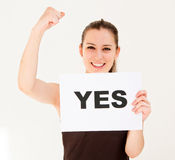 Woman with board yes Royalty Free Stock Image