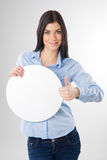 Woman with board. Young woman with blank circle board and showing thumb up sign Royalty Free Stock Images