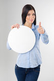 Woman with board. Young woman with blank circle board and showing thumb up sign Royalty Free Stock Photos