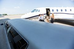 Woman Boarding Private Jet Stock Image
